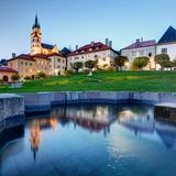 Slovakia - Kremnica with reflection in fountain at night Royalty Free Stock Images