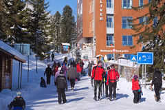 SLOVAKIA, STRBSKE PLESO - JANUARY 06, 2015: Skiers and other active tourists in Strbske Pleso. stock photo