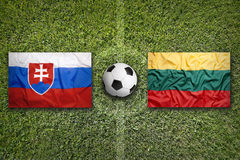 Slovakia vs. Lithuania flags on soccer field Royalty Free Stock Image