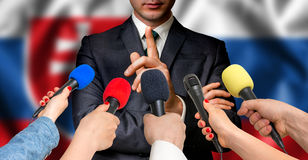 Slovakian candidate speaks to reporters - journalism concept Royalty Free Stock Photo