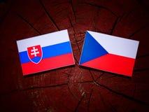 Slovakian flag with Czech flag on a tree stump  Stock Photos