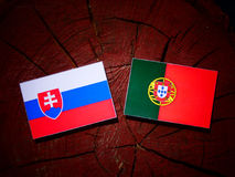Slovakian flag with Portuguese flag on a tree stump isolated. Slovakian flag with Portuguese flag on a tree stump royalty free illustration