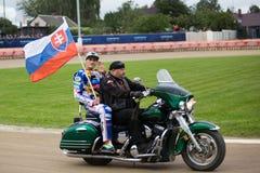 Slovakian rider Martin Vaculik with national flag Stock Images
