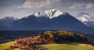 Slovakian Tatra mountains autumn landscape. With forest and clouds Royalty Free Stock Photo