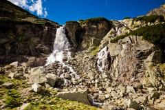 Slovakian Tatry Skok waterfall landscape. Beautiful Skok vodospad in slovakian Tatry mountains. Panorama of mlynicka valley stock photos