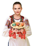 Slovakiskt målade easter för flicka innehav ägg Royaltyfri Foto