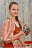 Slovakiskt målade easter för flicka innehav ägg Royaltyfria Bilder
