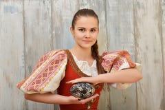 Slovakiskt målade easter för flicka innehav ägg Royaltyfri Fotografi
