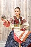 Slovakiskt målade easter för flicka innehav ägg Arkivbilder