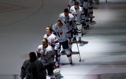 Slovanteam op ijs stock foto's
