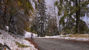 Slovenia. Autumn. The trail in the valley. Triglav. Slovenia. Autumn. First snow in the mountains. Road to the mountains. cyclist rides up stock video footage