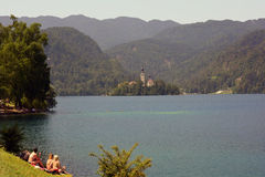 Slovenia, Bled. Bled, Slovenia - July 7th 2015: Unidentified people on Bled lake aka Blejsko Jezero and church on island Blejski Otok Royalty Free Stock Photography