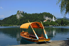 Slovenia, Bled. Slovenia, traditional rowing boats named Pletna on lake Bled and castle royalty free stock photos