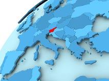 Slovenia on blue globe. Slovenia in red on blue model of political globe. 3D illustration Royalty Free Stock Image
