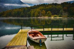 Slovenia, Bohinj Lake, Harbour with boat. Stock Image