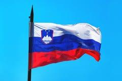 Slovenia flag against blue sky Royalty Free Stock Photo