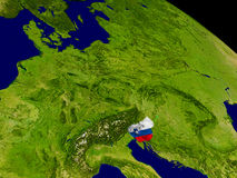 Slovenia with flag on Earth Stock Images