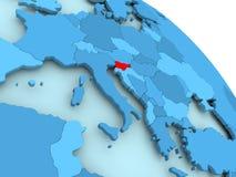 Slovenia on blue globe. Slovenia highlighted on blue 3D model of political globe. 3D illustration Stock Images