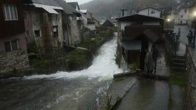 Slovenia. Kroparica river. Kropa village. Waterfall in the village. Rain. stock footage