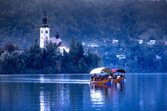 Slovenia. Lake Bled Local church boats Stock Images