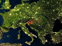 Slovenia in red from space at night Stock Photo
