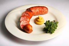Slovenia's Krajnska sausage on a plate Royalty Free Stock Photography