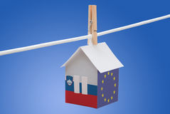 Slovenia, Slovenian and EU flag on paper house Royalty Free Stock Photo