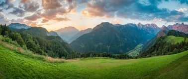 Slovenian Alps at Sunrise, Panorama. Slovenian Alps at sunrise, panoramic view of the Logar Valley in the Kamnik Alps, Europe stock photo