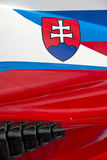 Slovenian flag on race car. The colors and crest of the national flag of Slovenia painted on the body work of a race car stock photos