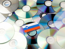 Slovenian flag on top of CD and DVD pile isolated on white. Slovenian flag on top of CD and DVD pile isolated Royalty Free Stock Photography