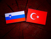 Slovenian flag with Turkish flag on a tree stump  Stock Image