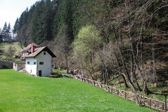 Slovenian House by Stream Stock Image