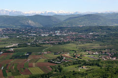 Slovenian landscape. Villages in the front, near Slovenian border with Italy, Julian Alps visible in the background Stock Photos