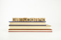 Slovenian language word on wood stamps and books Stock Photos