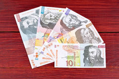 Slovenian money on a wooden background Royalty Free Stock Photos