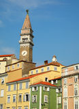 Slovenian skyline. A bell tower rises above houses in Piran, Slovenia Royalty Free Stock Images