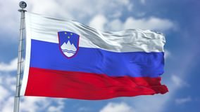 Slovenien flagga i en blå himmel Arkivbilder