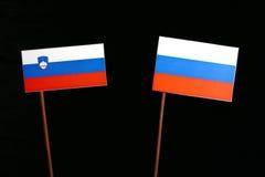 Slovensk flagga med den ryska flaggan på svart Arkivbilder