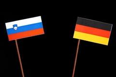 Slovensk flagga med den tyska flaggan på svart Royaltyfri Foto