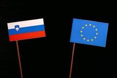Slovensk flagga med EU-flaggan för europeisk union på svart Royaltyfria Bilder
