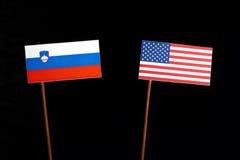 Slovensk flagga med USA flaggan på svart Royaltyfri Fotografi