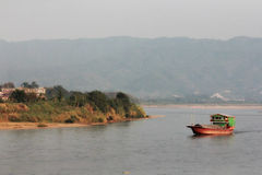 Slow Boat on the Mekong River Stock Photos