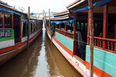 Slow boats on the Mekong river Laos Stock Photography
