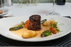 Slow braised sticky beef in a consomme Royalty Free Stock Photography