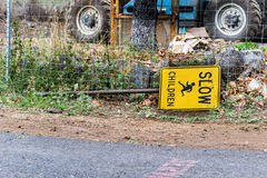 Slow children. In construction area, where is messy and very important sign is on a ground Royalty Free Stock Photo