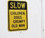 A slow children, dogs and grumpy old man sign. Stock Images