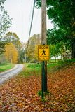 Slow Children at Play Sign. In a residential neighborhood in Massachusetts. Fall leaves are on the ground and the sky is cloudy stock photos