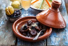 Slow cooked beef with prunes, figs, raisins and almonds - moroccan tajine. Slow cooked beef with prunes, figs, raisins and almonds - moroccan tajine stock photography