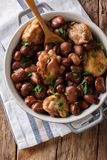 Slow cooked chicken with broad beans close up in a bowl. Vertica Stock Photos