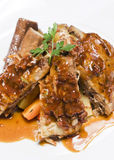 Slow-cooked lamb short ribs with mint jelly. Slow cooked lamb ribs served with gravy Royalty Free Stock Images